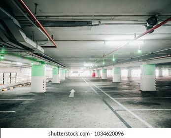 construction for automatic technology check for empty area of car parking lane in shopping mall with red fire extinguisher no the wall