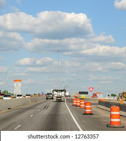 Construction Barrels Along The Interstate Highway - Traffic Along The Interstate Highway In Construction Zone,  Ohio USA