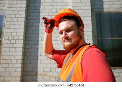 construction bearded worker in protective cask