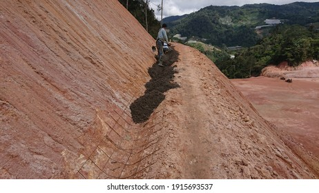 Construction of Berm Drain work at the cutted slope area flr collect all the surface run off and channel to nearest cascading drain as preventative on land slide, slope maintenance and run off.