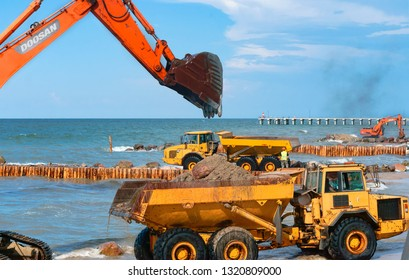 construction of breakwaters, construction equipment on the sea coast, Baltic sea, Kaliningrad region, Russia, July 15, 2018