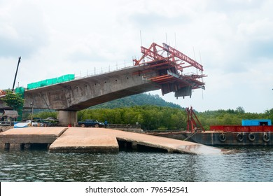 Construction of a bridge in progress with small ferry jetty on the front