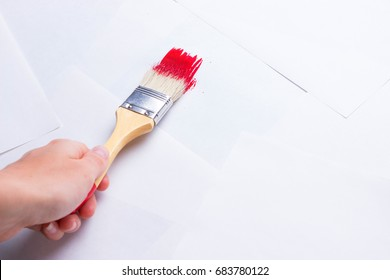 construction brush in hand on white background. not isolated. copy space