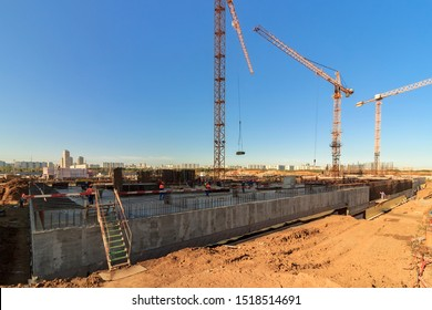 Construction of building Construction of apartment house. Concrete slab foundation building. foundation of reinforced concrete multistory apartment. Laborers working on modern construction Moscow 2019