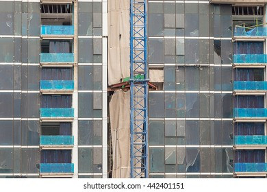 construction building in construction site with lift on the construction pole