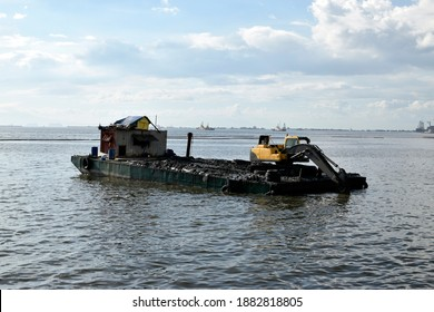construction bulldozer crane truck working, loded on floating steel barge - Shutterstock ID 1882818805