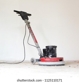 Construction business concept : Concrete surface sanding machine : Workers use concrete sanding machine to smooth the cement floor.