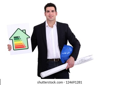 construction businessman holding an energy consumption label