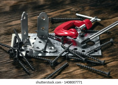 Construction or carpentry abstract background. Construction fasteners, clamp and screws on a workbench.