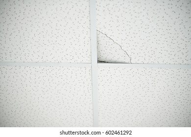 the construction of the ceiling, broken Ceiling tile built-in white ceiling close-up