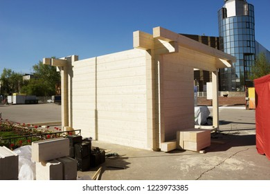 Construction of a commercial pavilion of glued wooden timber