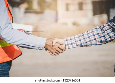 construction company handshaking with material supplier.