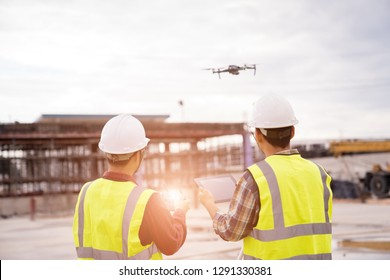 Construction concept of Engineer  working at construction Site with Drone over construction site.