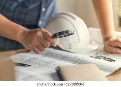 Construction concept , Foreman officer inspector defect about engineer&architect work home building before complete project ( Drawing is fake document made for stockphoto)