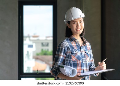 Construction concept , Foreman woman officer inspector defect about engineer&architect work home building before complete project