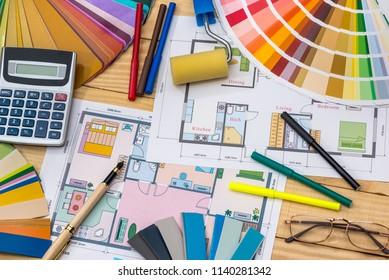 Construction concept: plan , color samples , roller , calculator