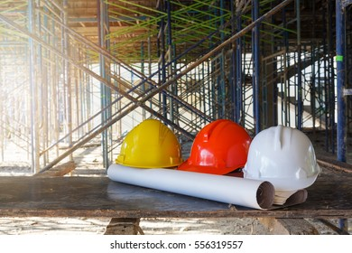 Construction concepts, Construction Site with Helmet and blueprint