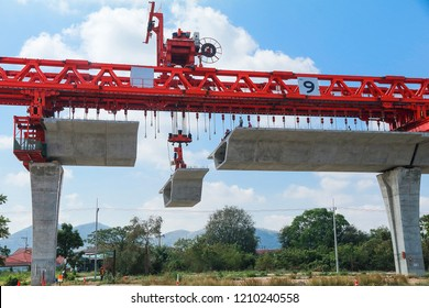 Construction crane of Bridge construction, segmental bridge box girders of express way in progress along the main road
