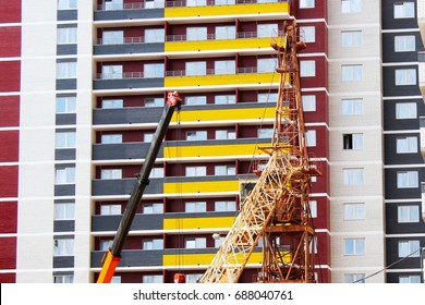 the construction crane and the building against the blue sky