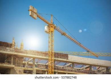 construction crane, building and blue sky.