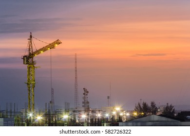 construction crane building on amazing sunset sky abstract background in the evening