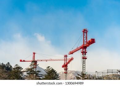 Construction crane at high building construction site.
