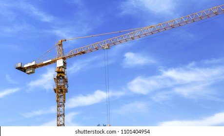 Construction crane on construction site over cloudy sky, Support and development business concept