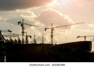 Construction crane on sunset of Silhouette.