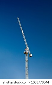 Construction Crane at Rest with Deep Blue Sky