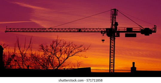 Construction crane silhouette in the sunset