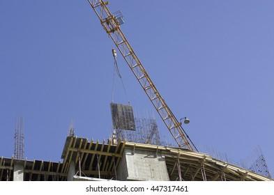 construction crane at a construction site against the sky