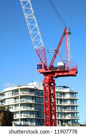 Construction crane working on completion of a building.