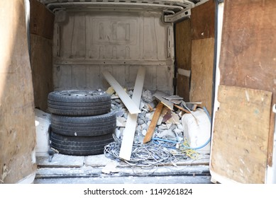 Construction debris in the back of a truck trailer