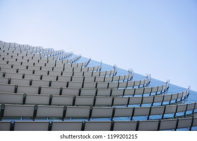 Construction detail of a contemporary building glass façade with white curved slats