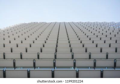 Construction detail of a contemporary building glass façade with white slats