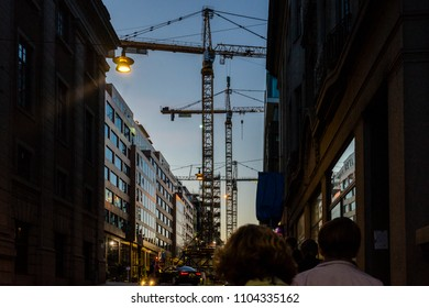 Construction development/Stockholm skyline during late evening dominated by huge cranes involved in construction projects that will eventually change the city shape. Stockholm, Sweden, May 19, 2018.