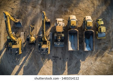 Construction dirt moving equipment lined up for the night.