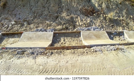 Construction of a ditch with cement slabs in an open angle