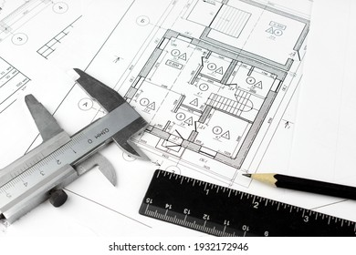 Construction drawings and plan tools. Close-up of Architect engineer drawing plan