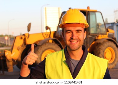 Construction driver with excavator on the background