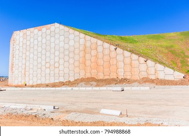 Construction earthworks industrial landscaping roads with high inter locking concrete blocks for retaining walls structures on new development zone.
