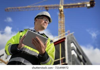 Construction engineer against blue sky