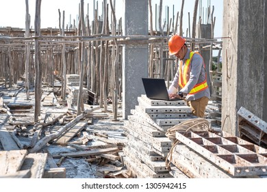 Construction engineer and architect planning with laptop, using technology at construction site