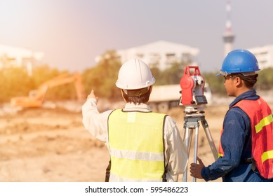 Construction engineer with foreman worker checking construction site for new Infrastructure construction project. photo concept for engineering work.