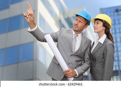 Construction engineer in front of modern building