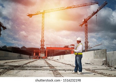 construction engineer in hardhat with using laptop on  construction.construction,engineer,site,management,safety,civil,workers