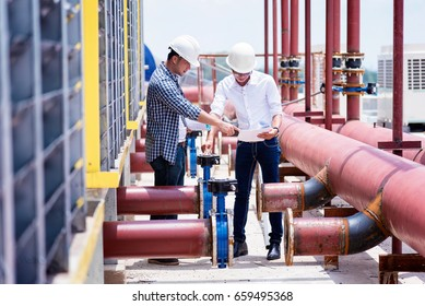 Construction engineer inspecting pipeline air conditioning system.