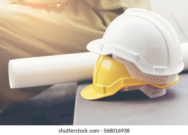 Construction Engineer with safety hardhat for safety and protect head equipment  tools. Safety helmet hard hat white yellow. Worker safety in construction site. Engineer concept