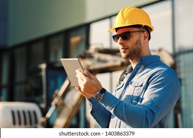 Construction engineer using digital tablet on the construction site