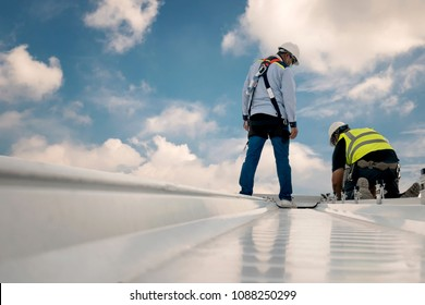 Construction engineer wear safety uniform inspection metal roofing work for roof industrial concept with copy space - Shutterstock ID 1088250299